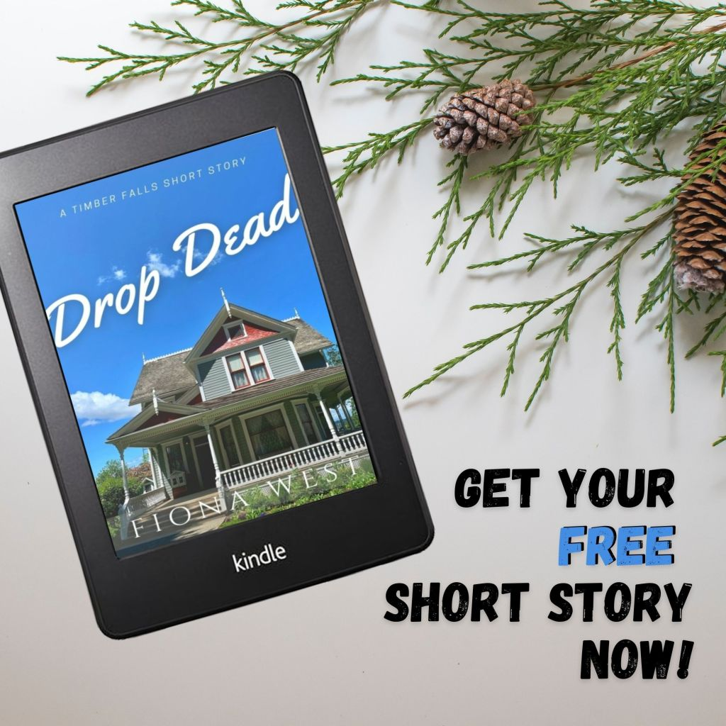 """A blue Victorian house is set against a bright blue sky. The title reads """"Drop Dead by Fiona West."""" There are pine branches around the Kindle."""